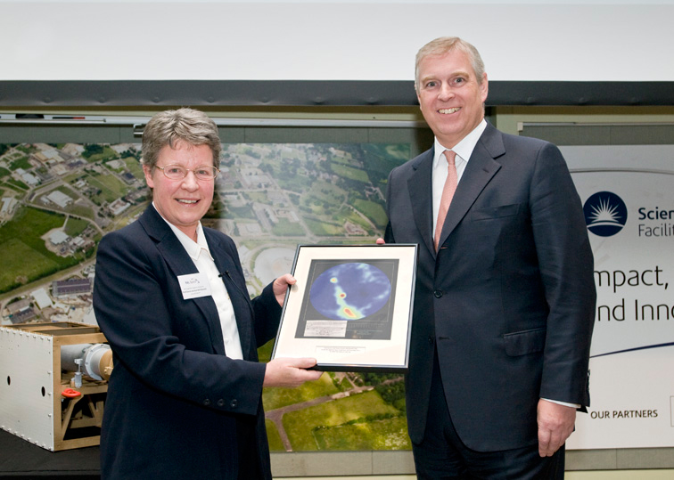 Professor Dame Jocelyn Bell Burnell being presented with an all sky image of Pulsar B919+21 by HRH Prince Andrew The Duke of York