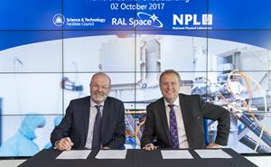 Dr Brian Bowsher, CEO STFC and Dr Peter Thompson, CEO NPL sign an agreement to bring together the two organisations' expertise.