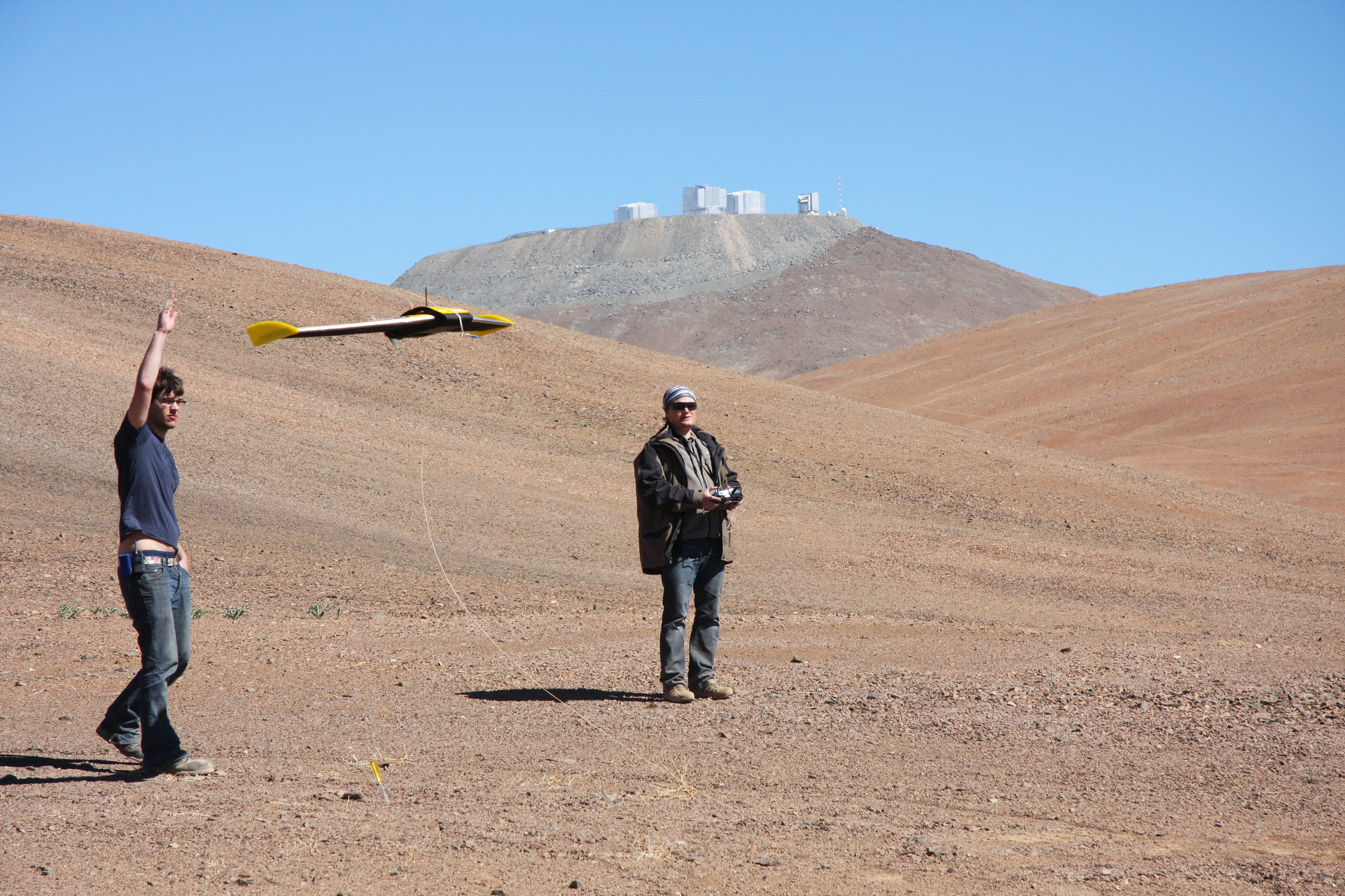 UAV being deployed over the Atacama desert with ESO observatory in the background​