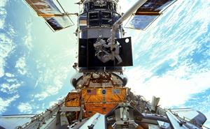 Astronaut repairing the Hubble Space Telescope.