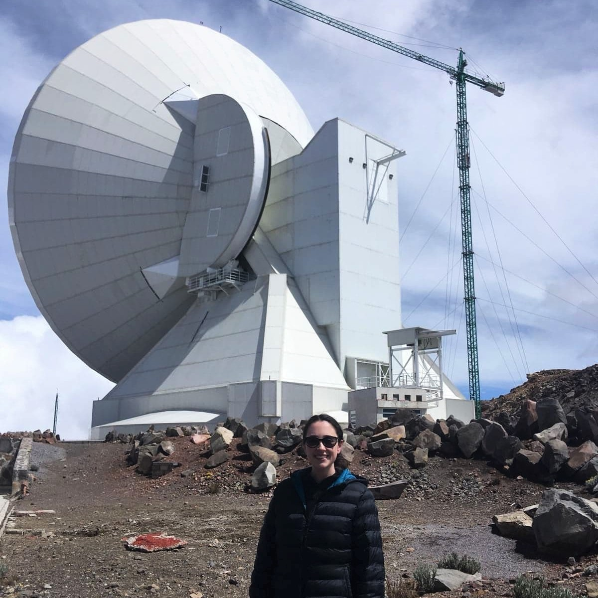 Eimear Gallagher is standing in front of the Large Millimetre Telescope